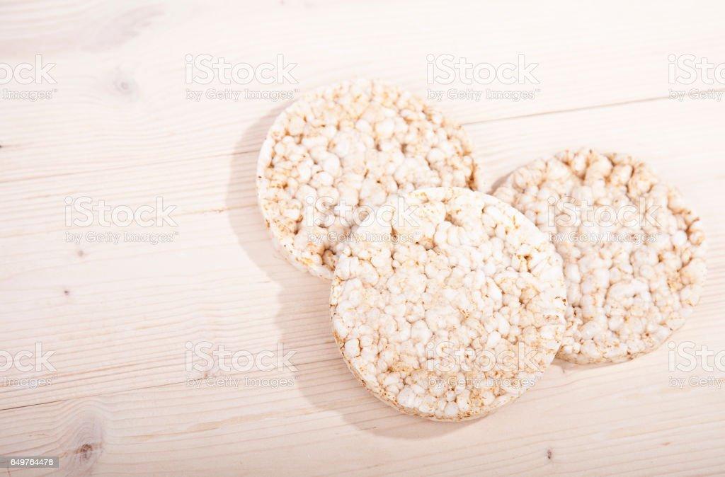 White rice waffles on wooden background stock photo