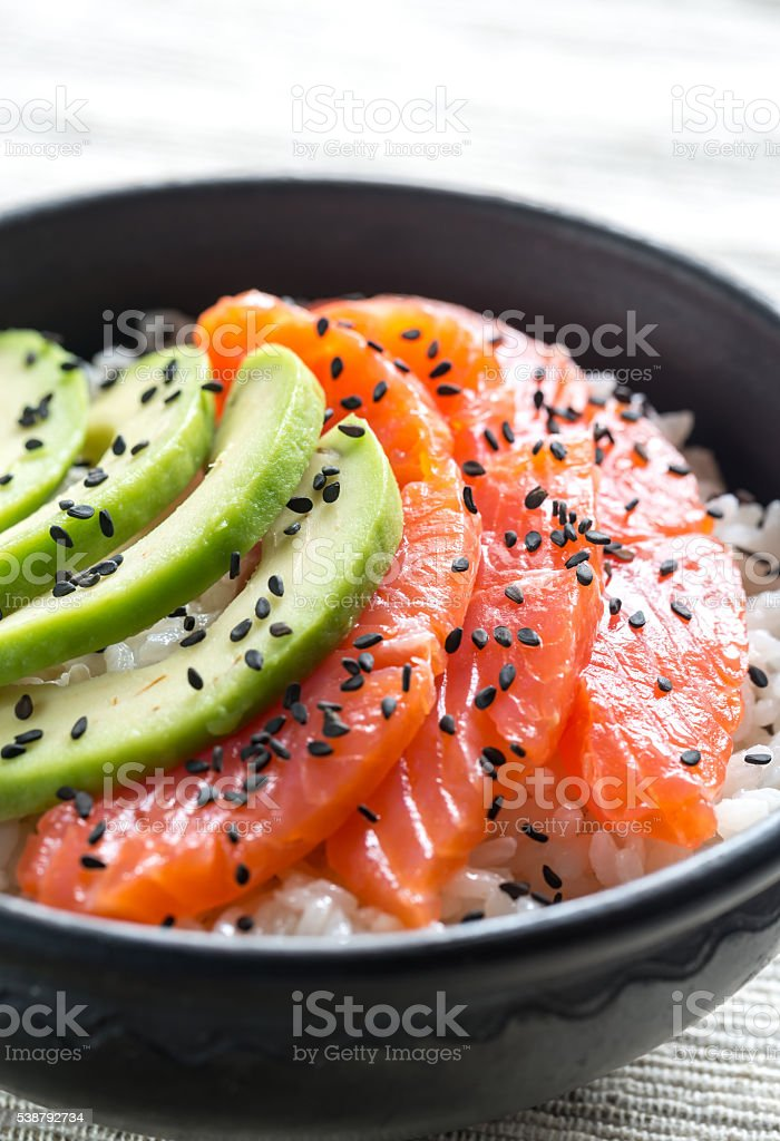 White rice with salmon and avocado stock photo