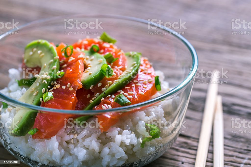 White rice with salmon and avocado stock photo
