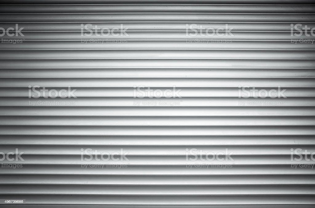 White ridged metal wall background texture stock photo