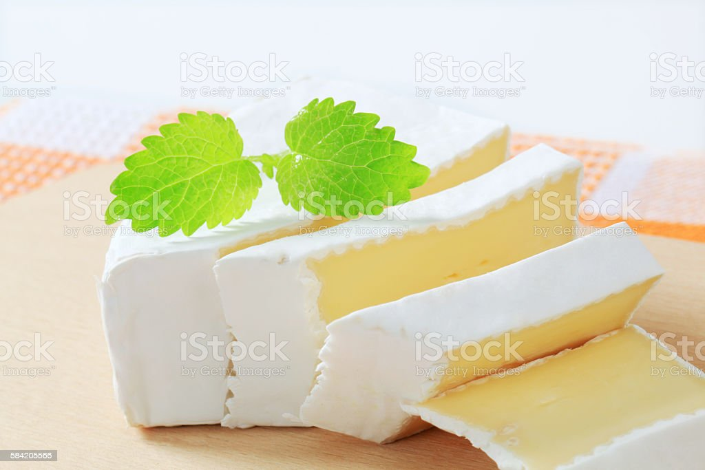 white rind cheese stock photo