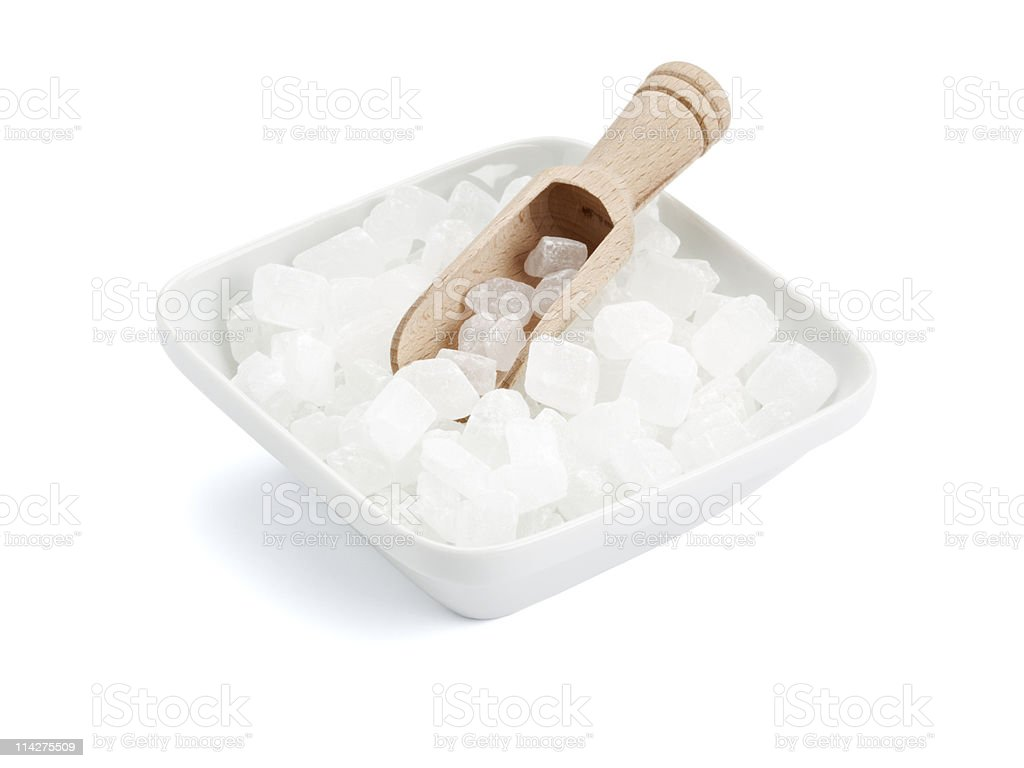 white rock candy in square bowl with wooden shovel royalty-free stock photo