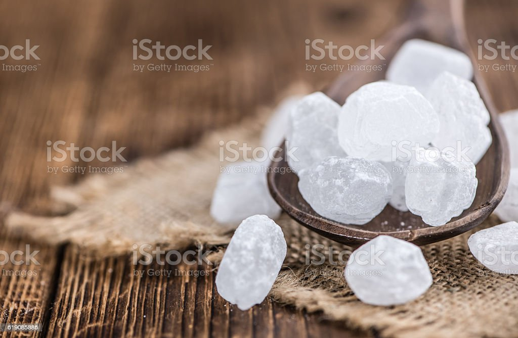 White Rock Candy on wooden background stock photo