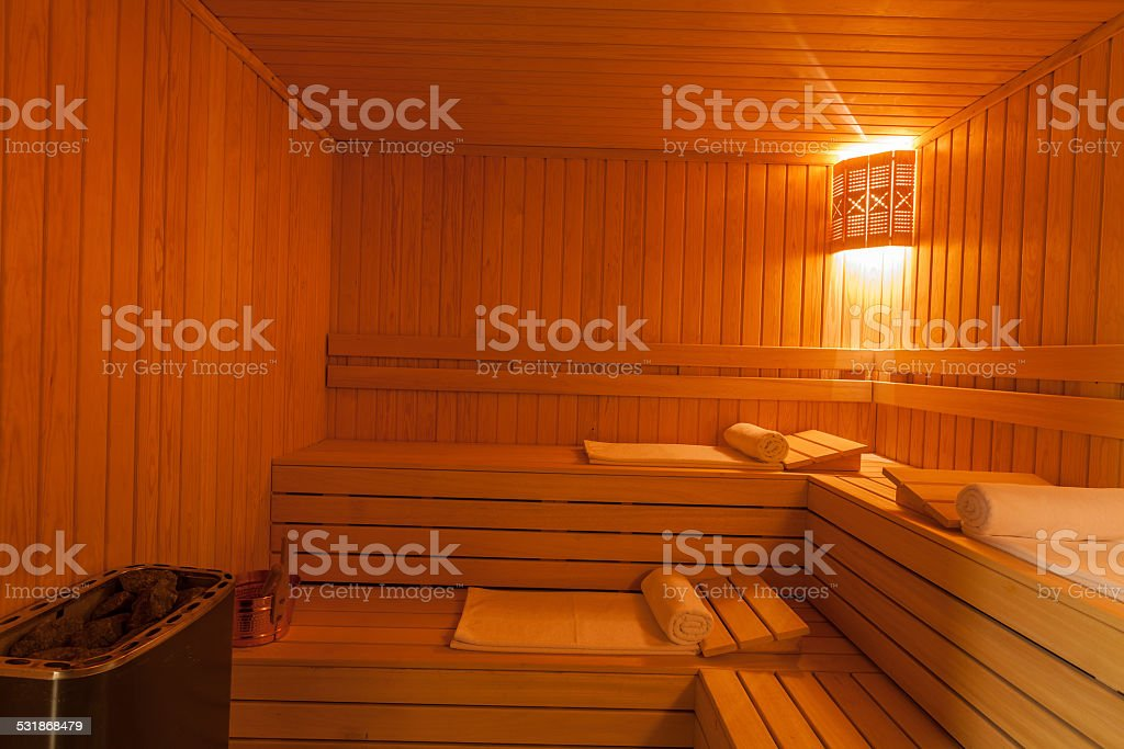 white rolled towels in a sauna stock photo