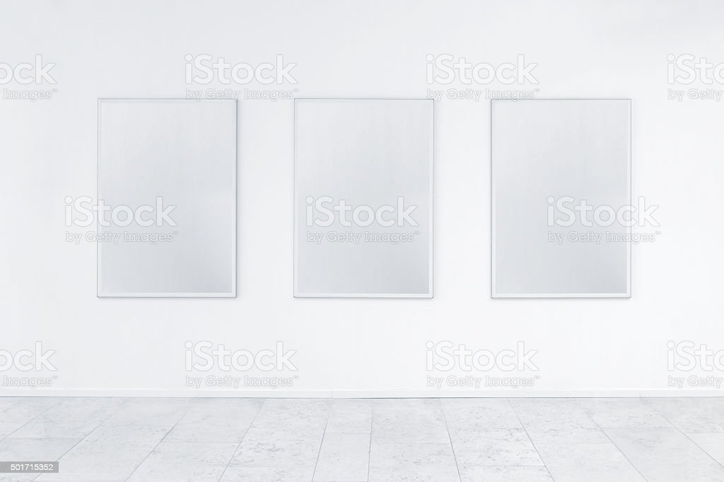 White room with posters stock photo