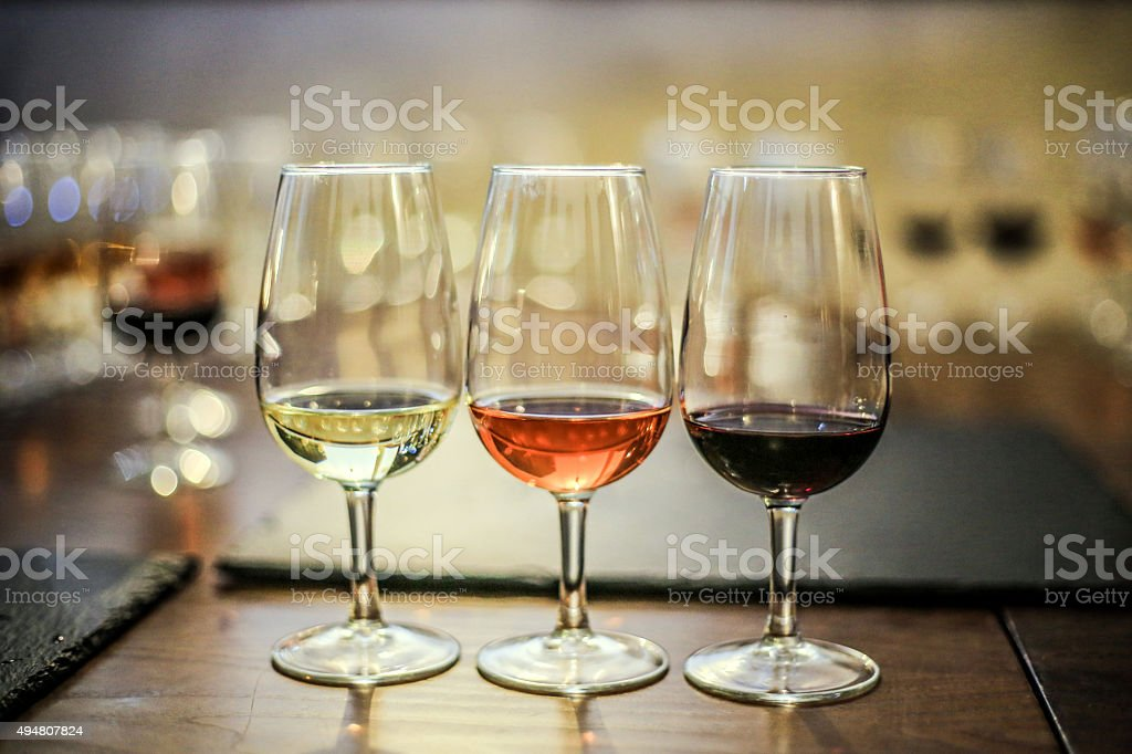 White, rosé and red wine stock photo