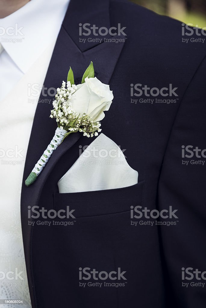 White Rose Boutineer on Black Tux royalty-free stock photo