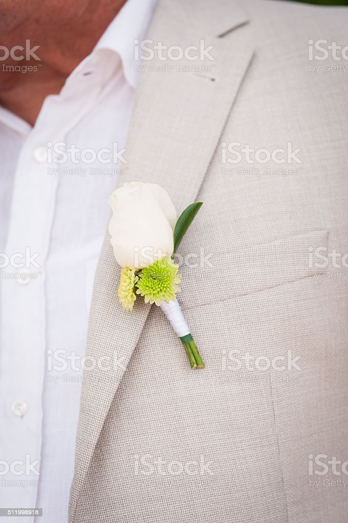 White rose boutonniere stock photo