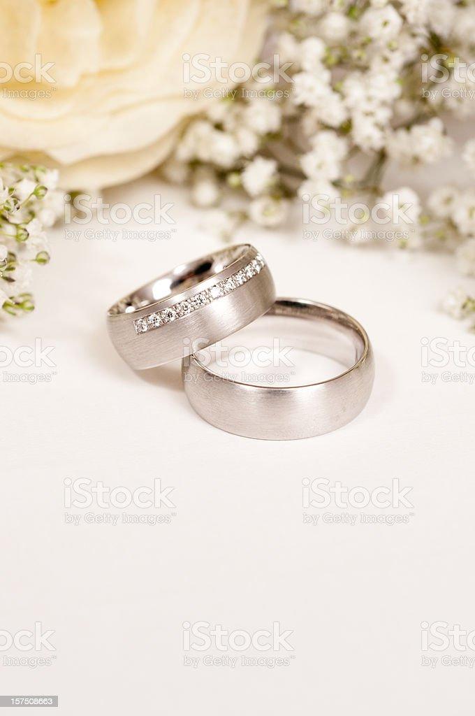 white rose with wedding ring and gypsohila stock photo