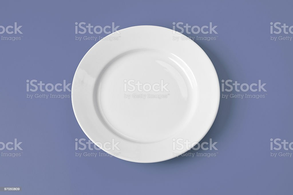 White round plate on sky blue background royalty-free stock photo