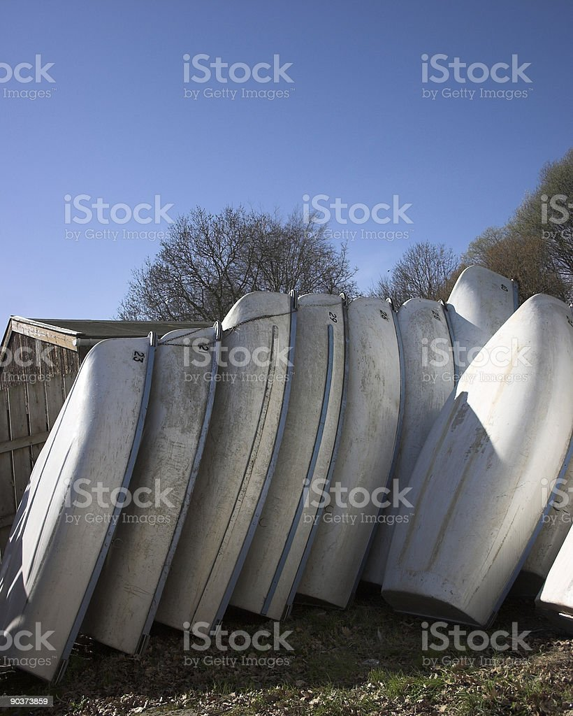 white rowing boats stacked royalty-free stock photo