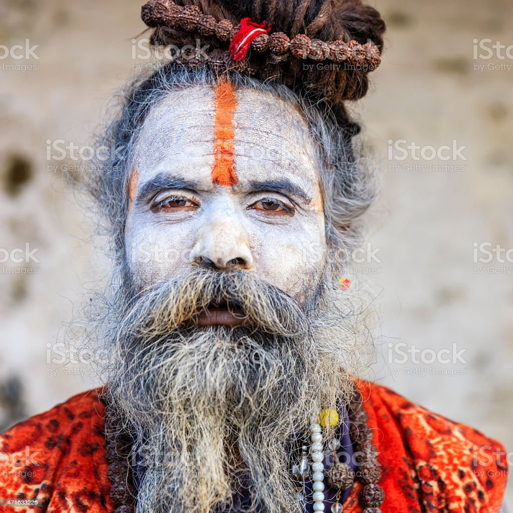 White Sadhu - indian holyman sitting in the temple stock photo