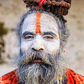 White Sadhu - indian holyman sitting in the temple
