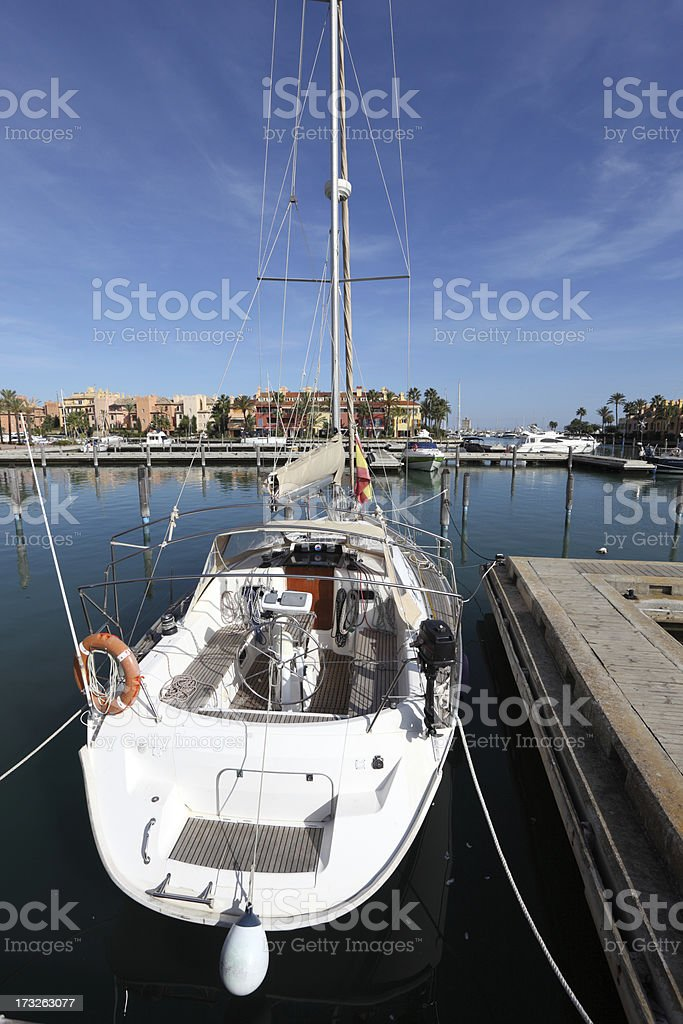 White sail yacht in the marina royalty-free stock photo