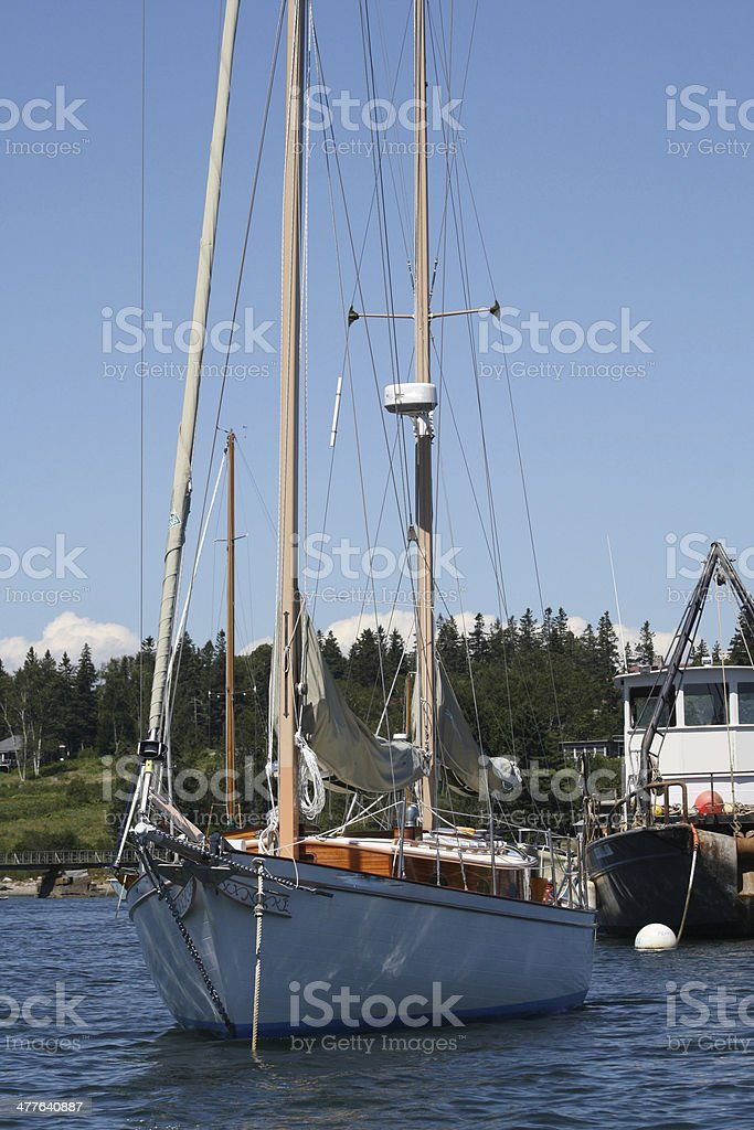 White Sailboat at Anchor in a Maine Harbor royalty-free stock photo