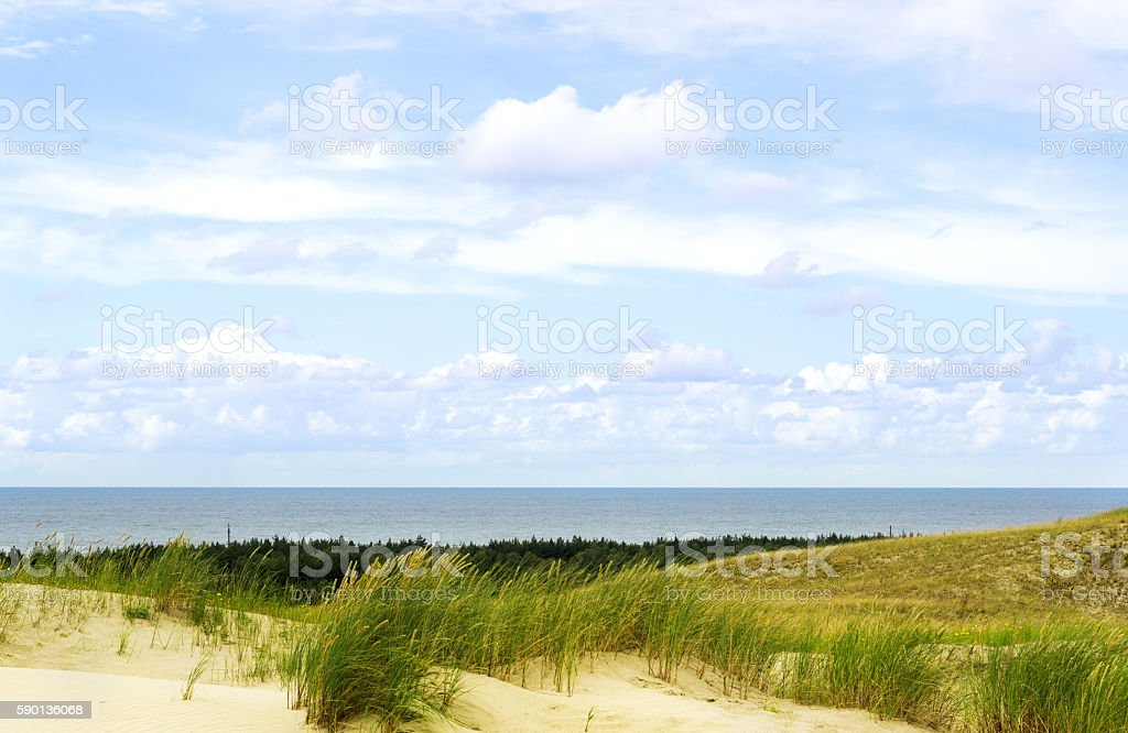 White Sailboat On The Background Of Dunes And Blue Sk stock photo