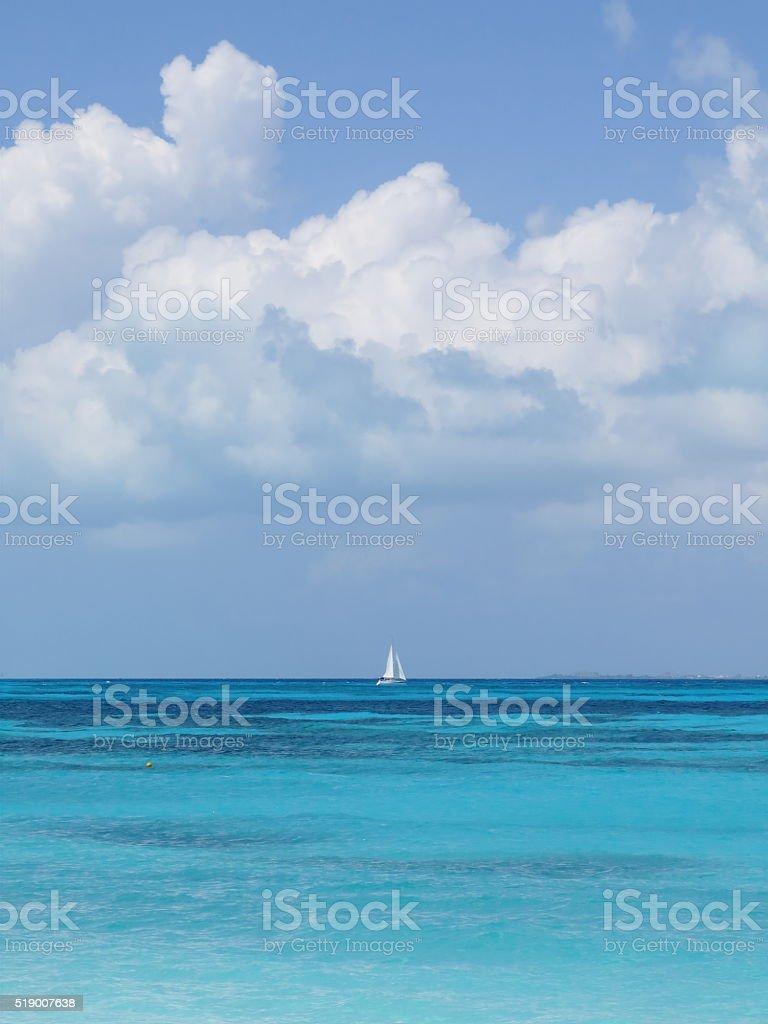 White Sailboat on the Beautiful Blue Sea stock photo
