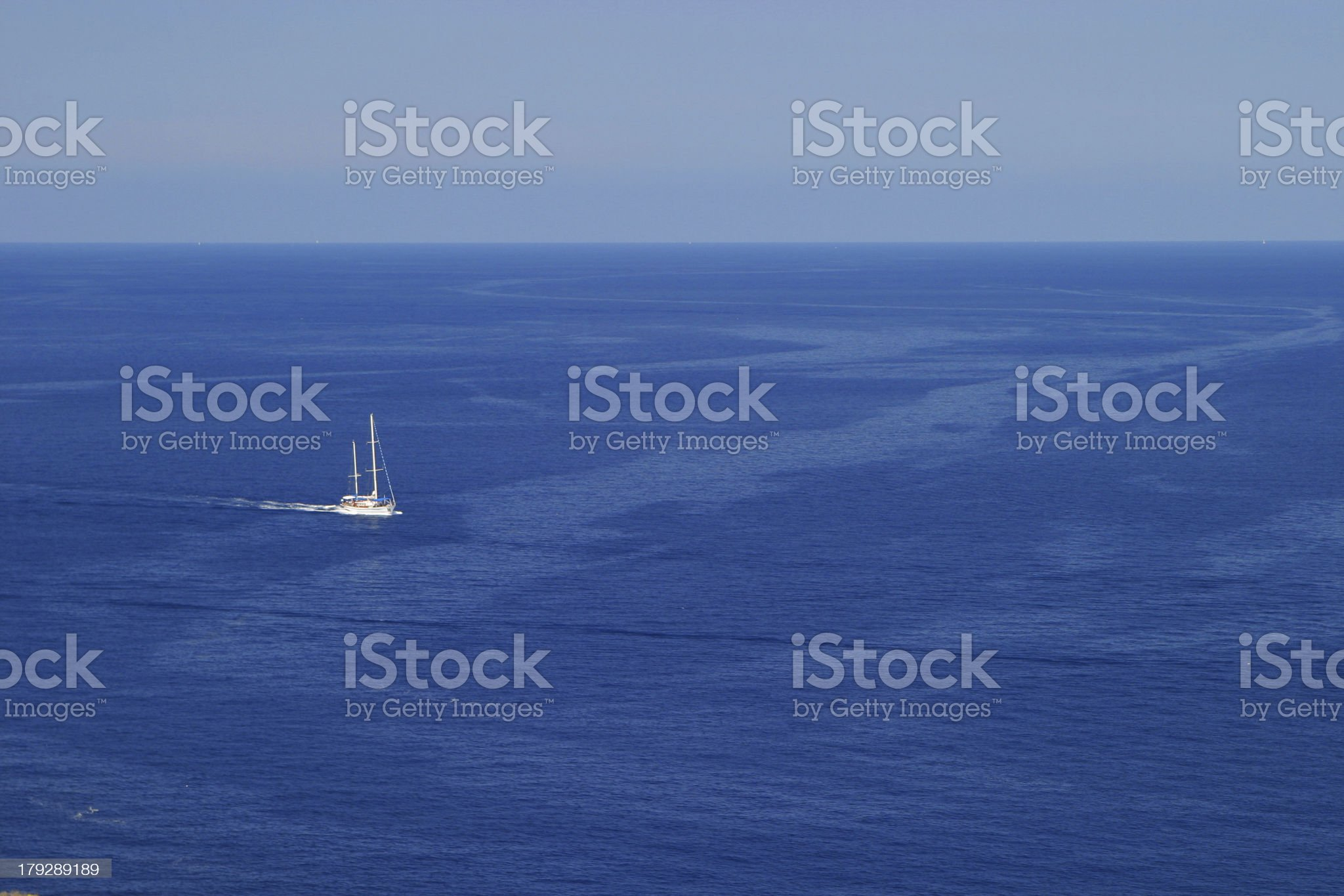 White sailing boat on blue waters royalty-free stock photo