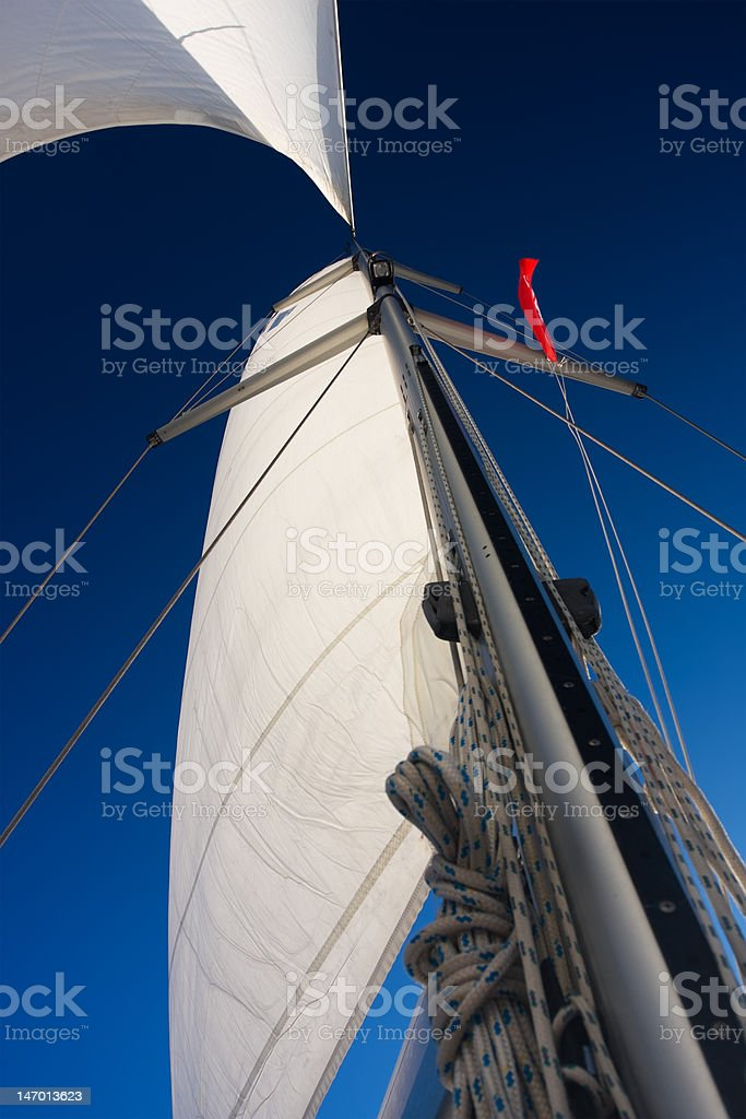 white sails against blue sky royalty-free stock photo