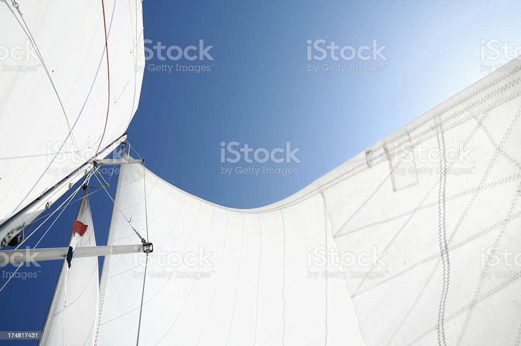 White sails against blue sky seen from below royalty-free stock photo