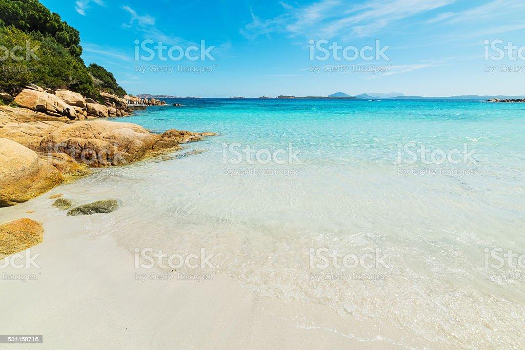 white sand and blue sea in Capriccioli beach stock photo