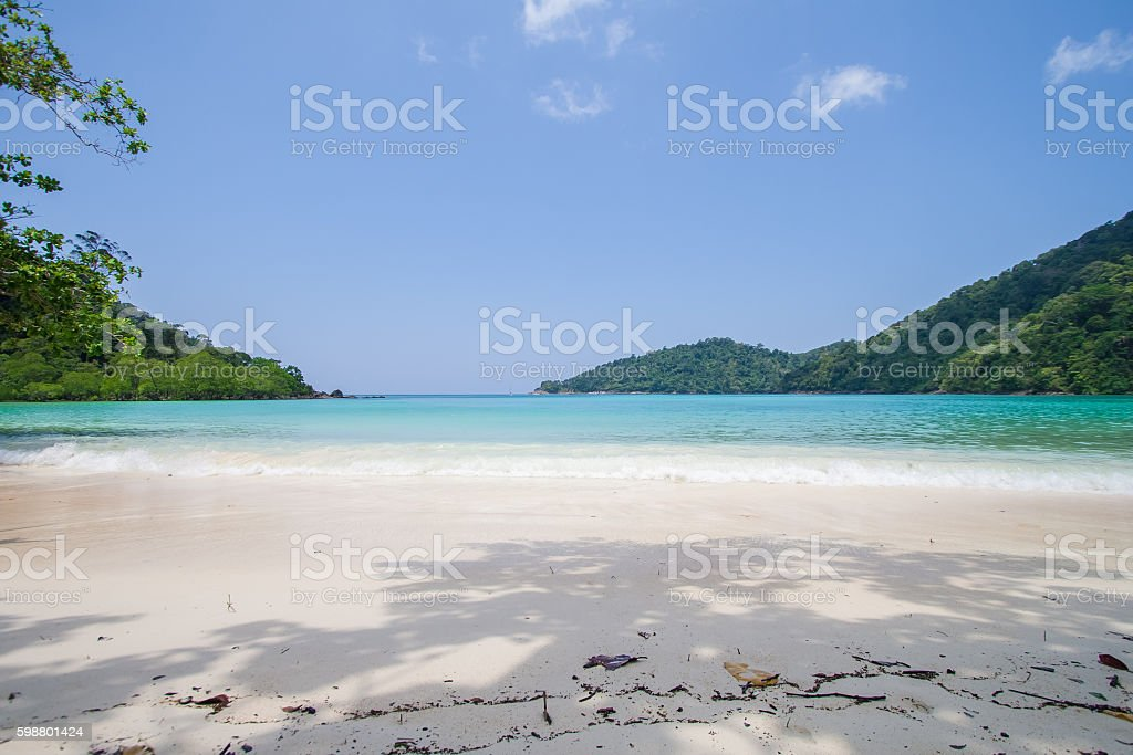 white sand and blue sea in the fresh sunny day stock photo