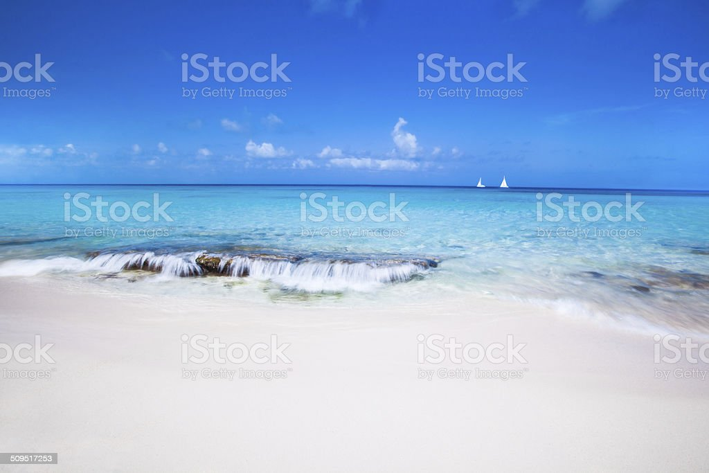 White Sand and Blue water stock photo
