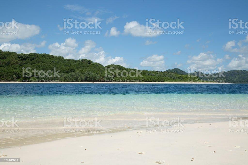 White sand beach and blue sky stock photo