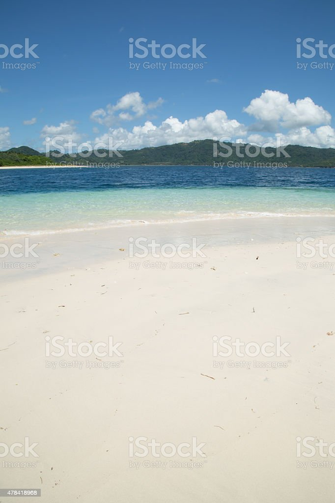 White sand beach and island stock photo