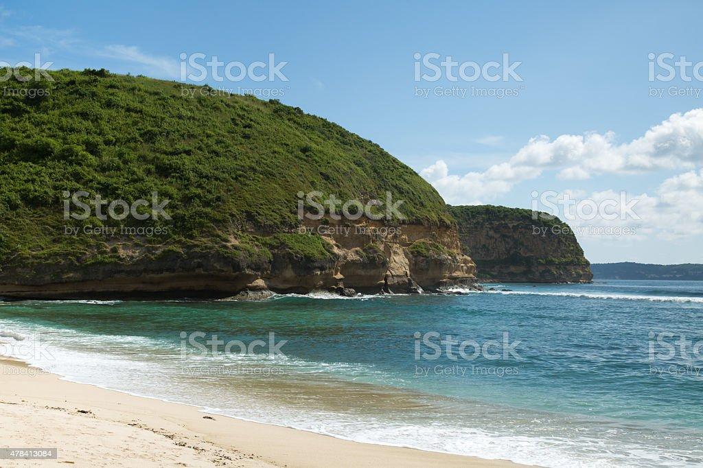 White sand beach blue sea and green mountain background. stock photo