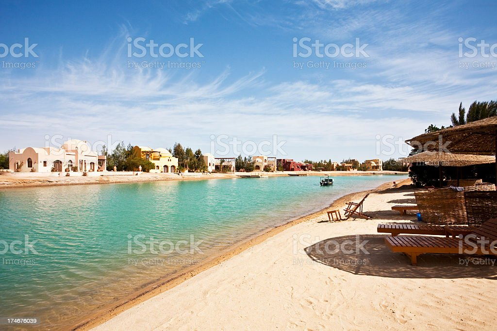White sand beach resort in Egypt with white houses and huts stock photo