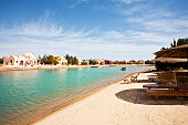 White sand beach resort in Egypt with white houses and huts
