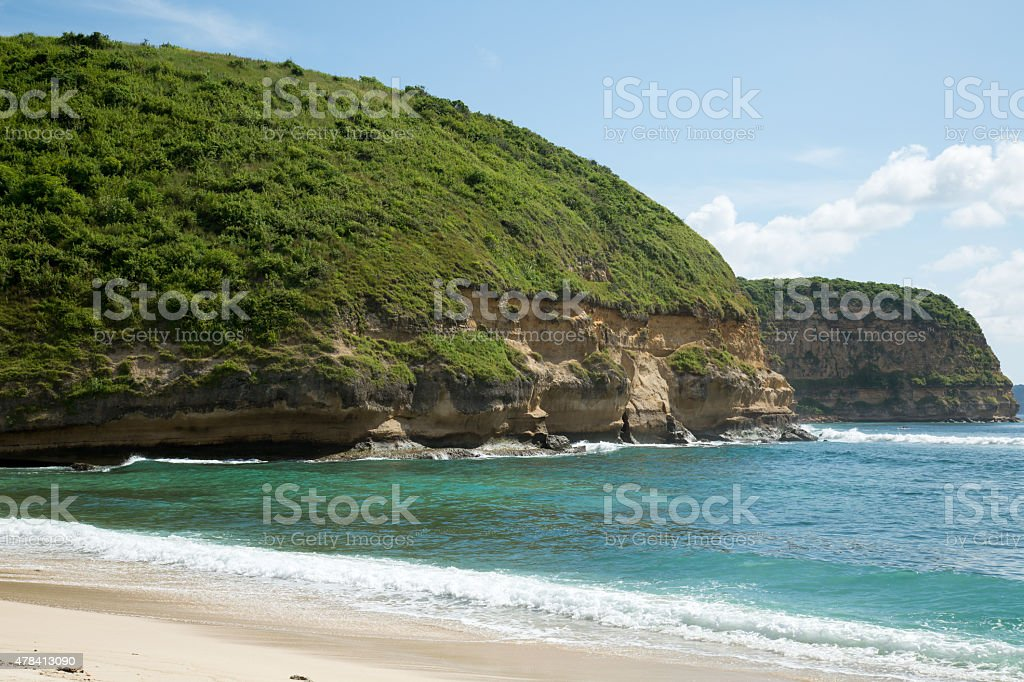 White sand beach white wave with deep green ocean. stock photo