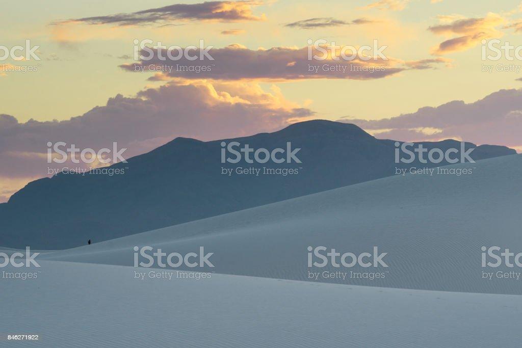 white sand desert in the evening stock photo