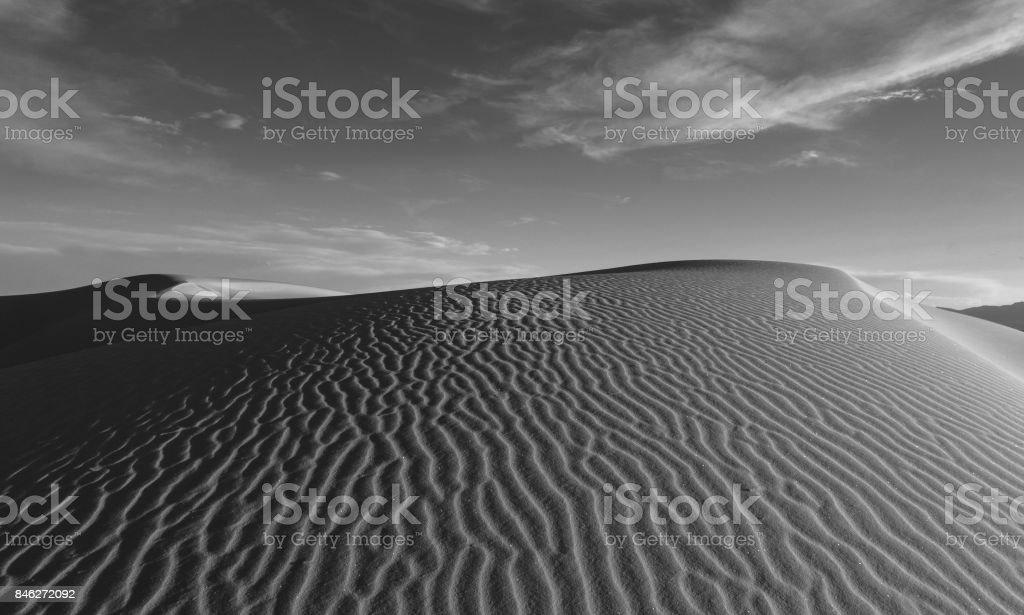 white sand dune stock photo