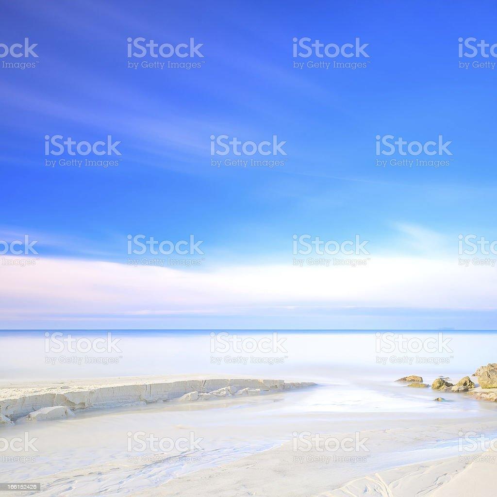 White sand dunes beach, rocks, ocean and sky royalty-free stock photo
