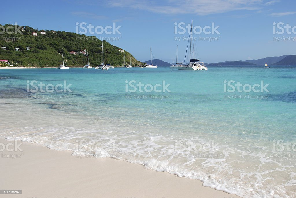White sand paradise beach with boats on the blue sea stock photo