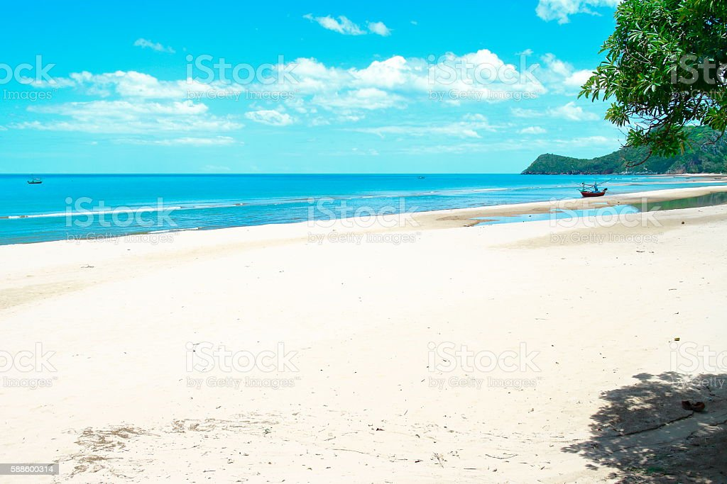 White sands beach and clouds horizon blue sky stock photo