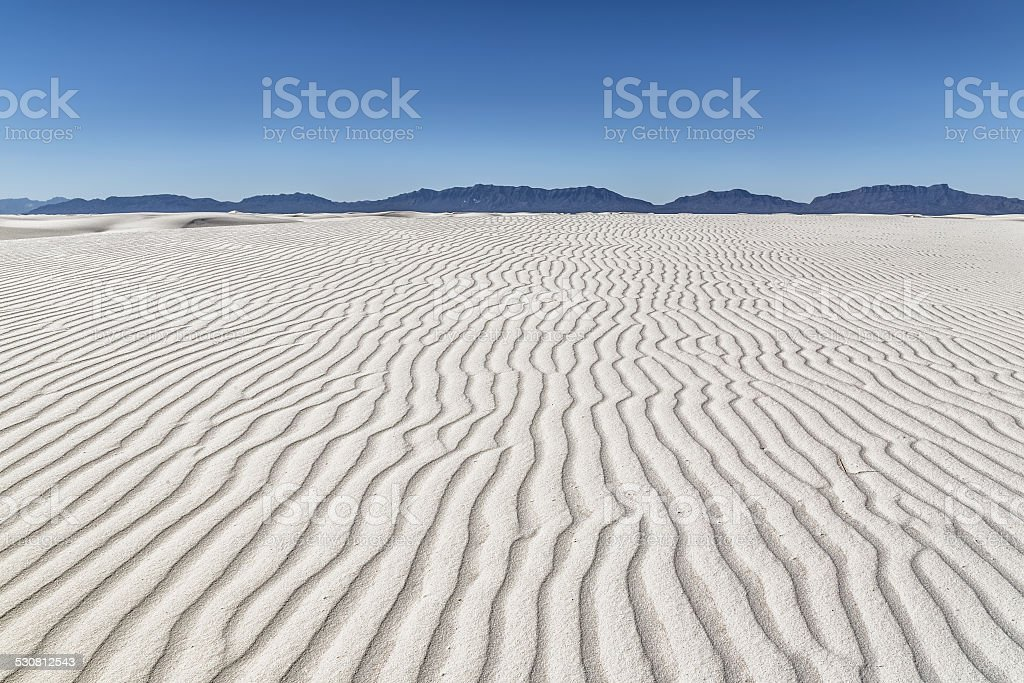 White Sands National Monument dune shaped by the wind stock photo