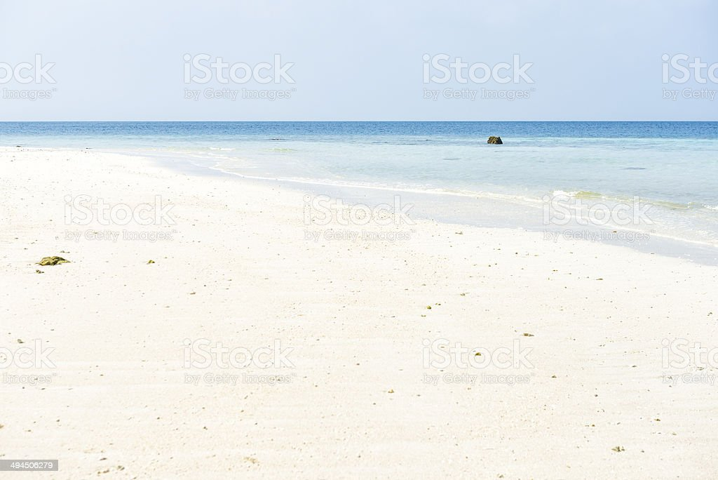 A white sandy beach in India featuring light blue calm water stock photo