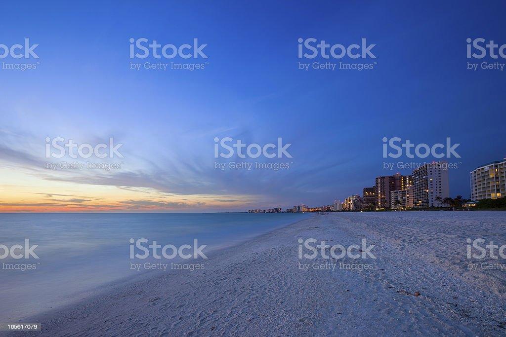 White Sandy Beach Resort at Sunset stock photo