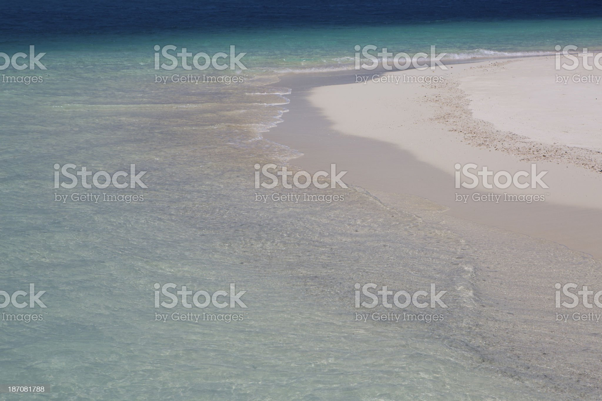 White Sandy Beach, Teal Blue Indian Ocean in the Maldives royalty-free stock photo