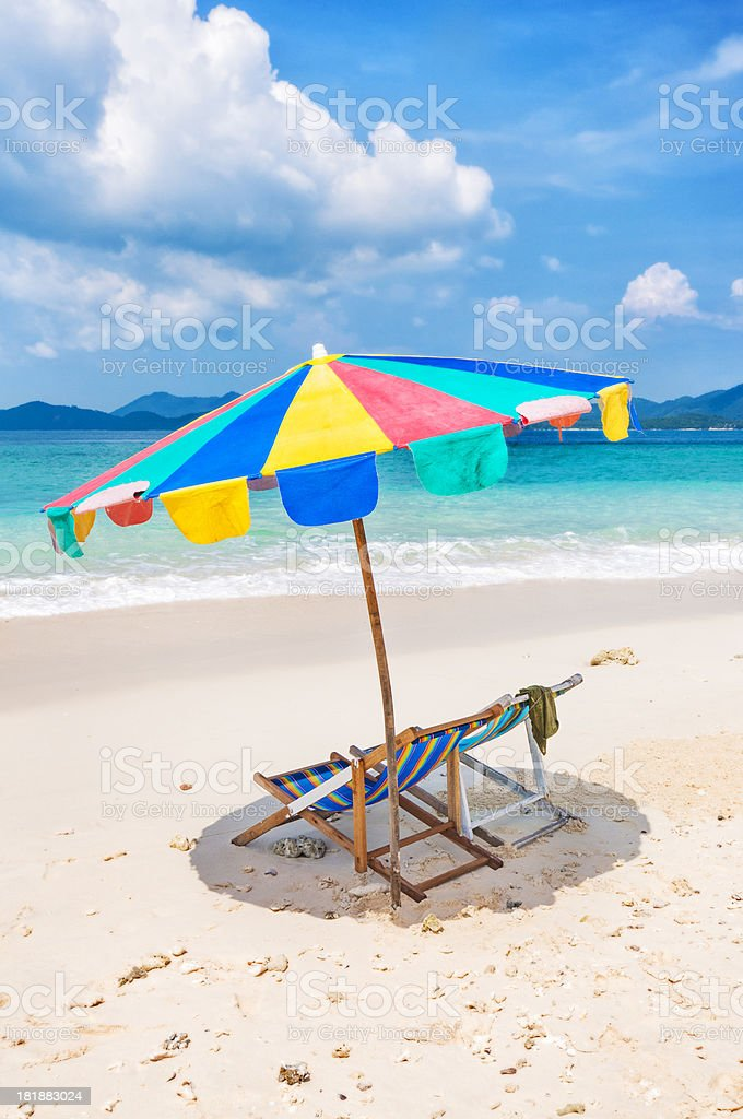 White Sandy Beach with Chairs and Umbrellas royalty-free stock photo