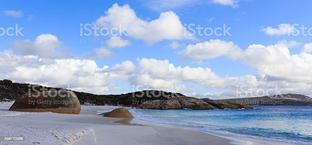 White Sandy Beach with Huge Boulders at Pretty Little Beach stock photo