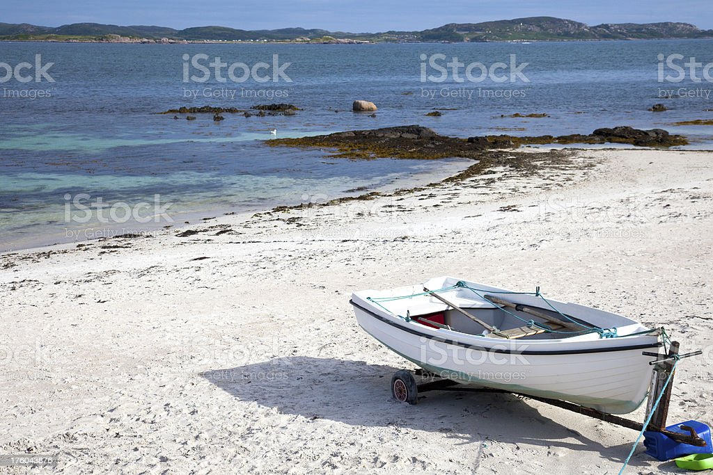 White sandy beach with rowing boat, Iona royalty-free stock photo