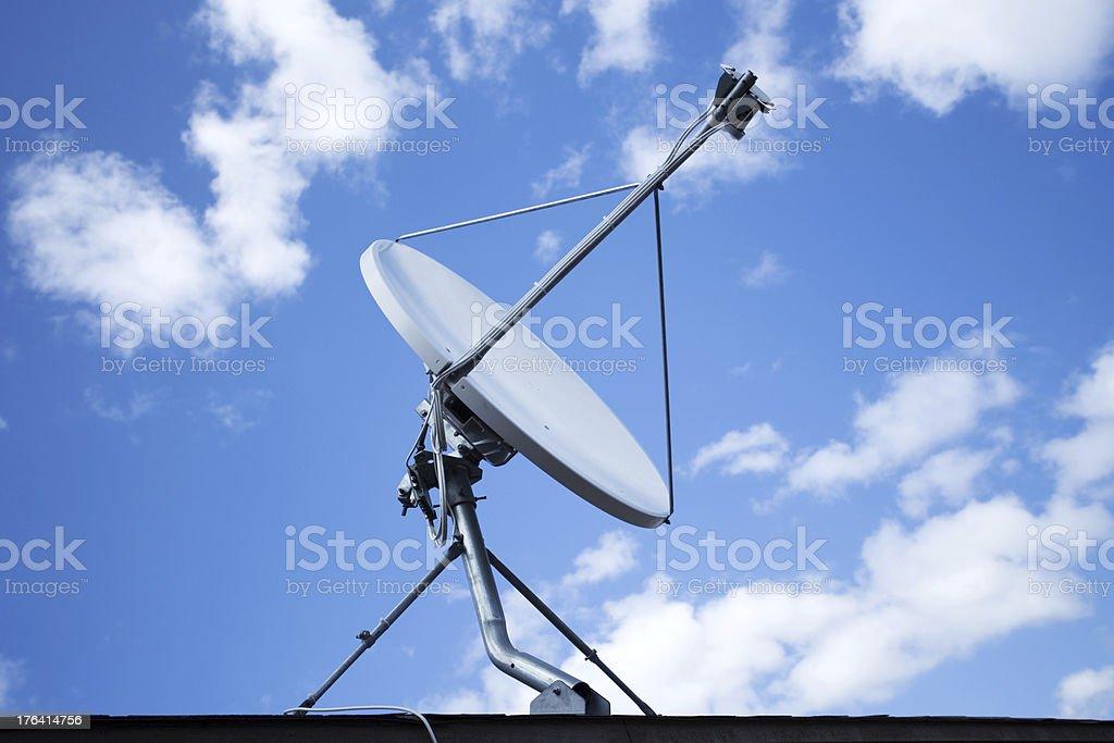White satellite dish with blue sky royalty-free stock photo