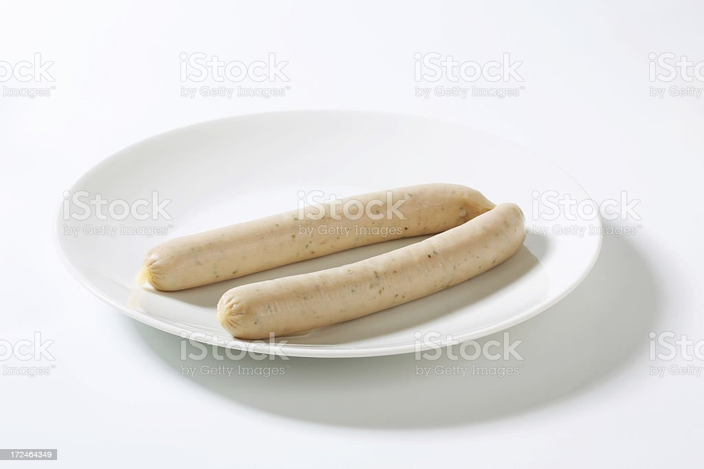 White sausage on a plate royalty-free stock photo