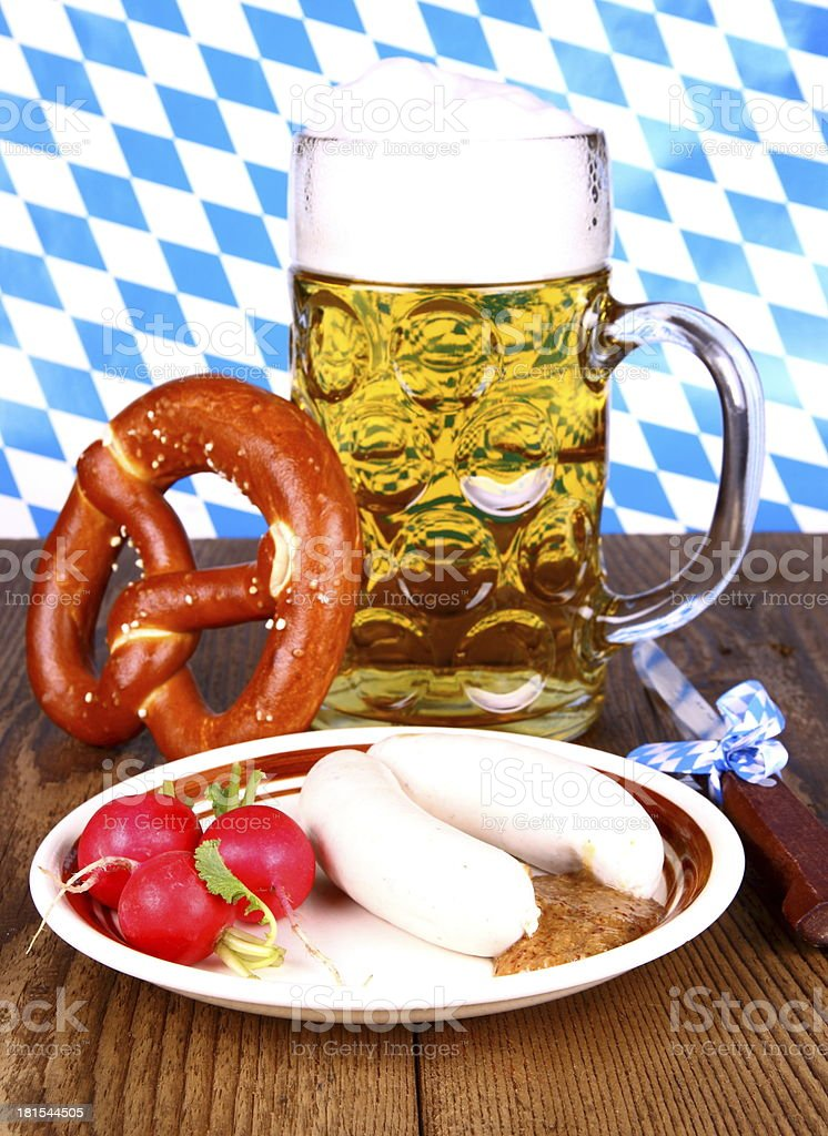 White sausage, pretzel, beer, radish with mustard stock photo