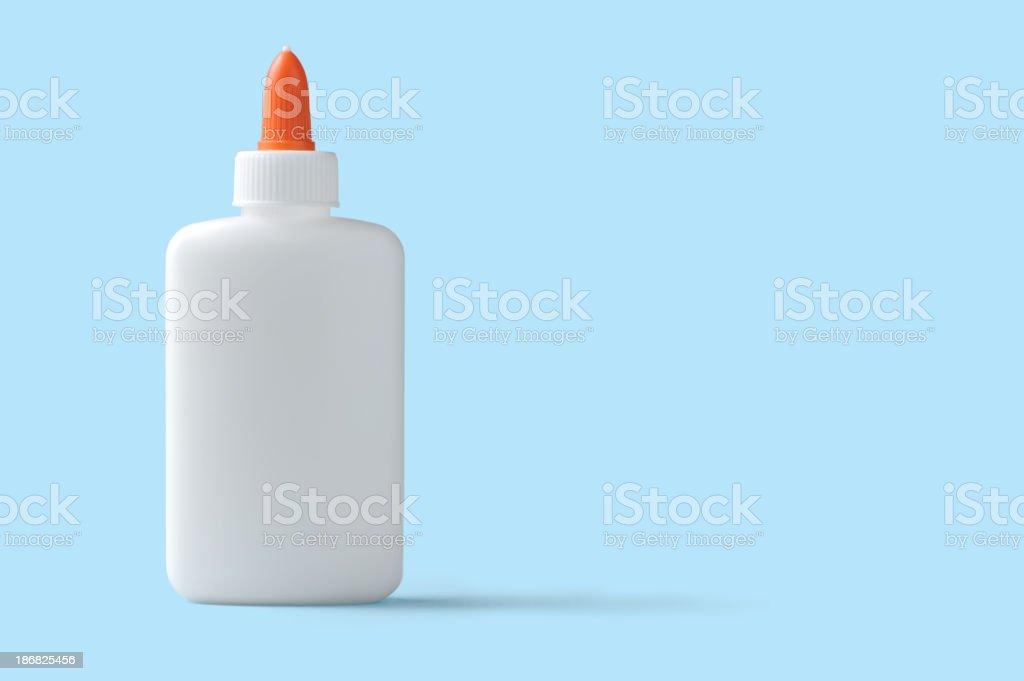 White School Glue on Blue Background stock photo