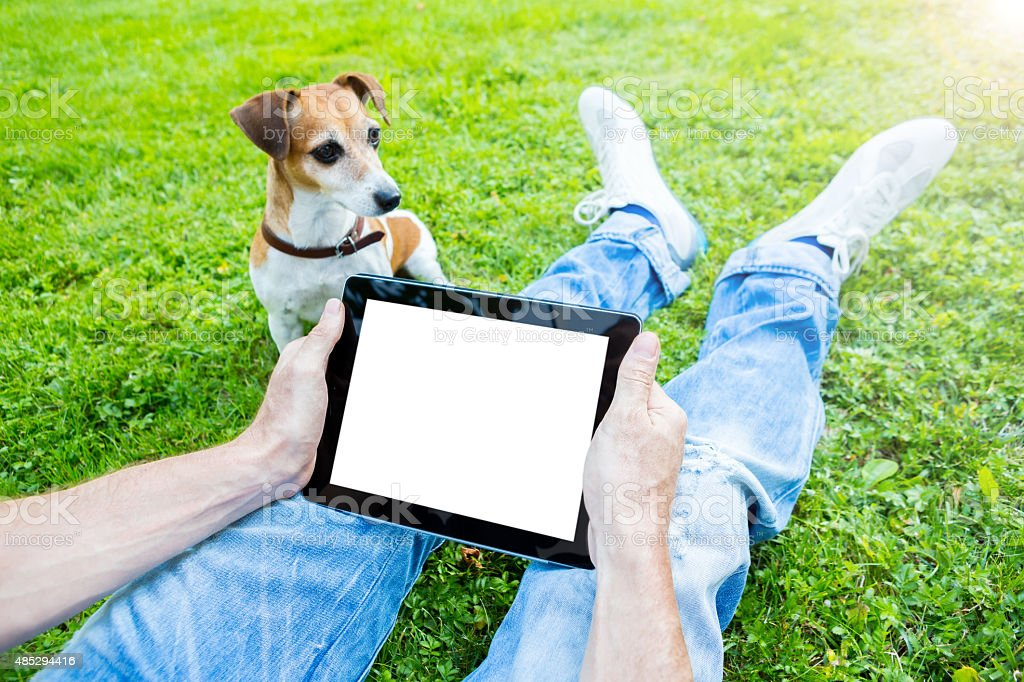 White screen touchpad. Man with dog stock photo